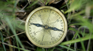 Image of a compass in the grass